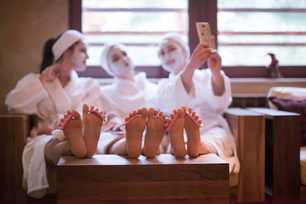 Ladies getting a spa treatment pedicures and facials for women