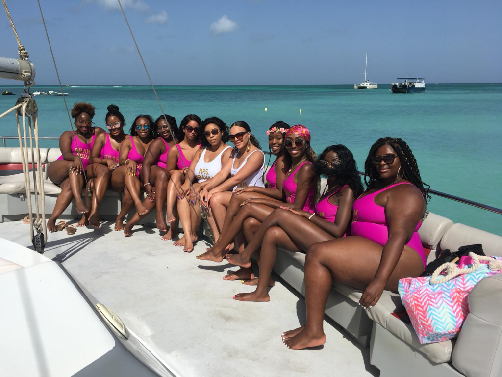bachelorette party on boat with matching bathing suits
